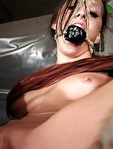 Extreme gagged Nicole was bound to a monolit CO2 bottle.