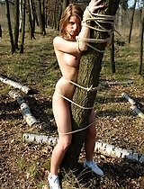 Tied busty girl in the open-air