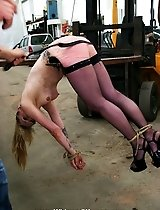 Juicy blonde Christina gets tied up to a forklift and most brutally punished by the lash at members command!